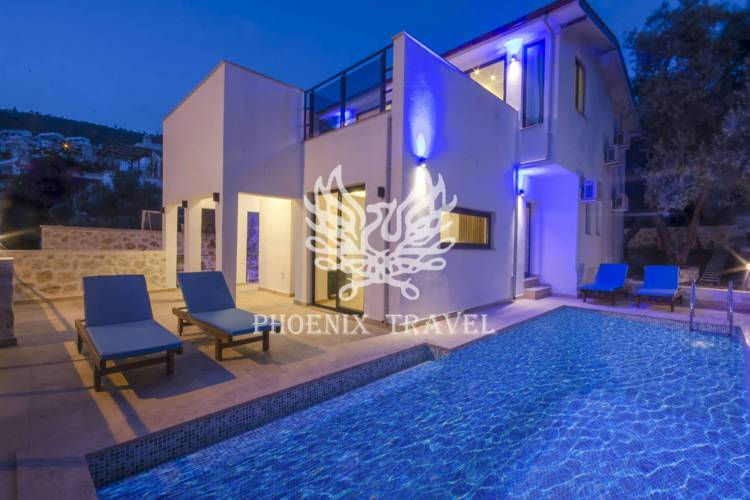 A newly built 8 person luxury villa with magnificent shield view among squid bougainvilleas